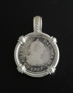 Spanish one reale bust coin pendant