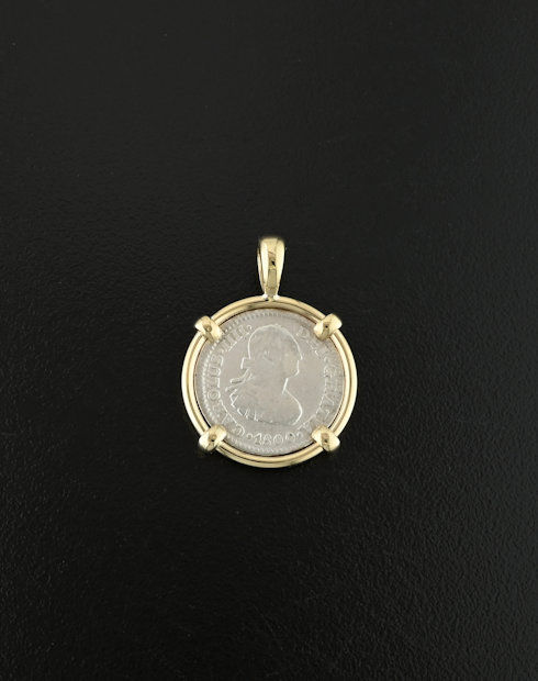 spanish bust half real coin pendant