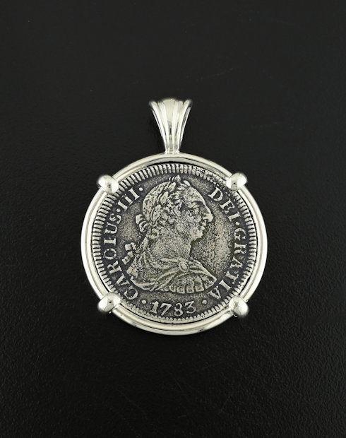 el cazador shipwreck two reales coin pendant